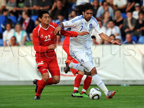 25 05 2010  FIFA World Cup perperations. Friendly match North Korea v Greece played in Austria. Picture shows Ahn Hak Yong PRK and GeorgiSamaras GRE