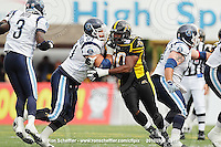 September 6, 2010; Hamilton, ON, CAN; Hamilton Tiger-Cats defensive tackle Demonte' Bolden (90) and Toronto Argonauts offensive guard Cedric Gagne-Marcoux (61). CFL football: Labour Day Classic - Toronto Argonauts vs. Hamilton Tiger-Cats at Ivor Wynne Stadium. The Tiger-Cats defeated the Argonauts 28-13. Mandatory Credit: Ron Scheffler.