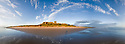 Bamburgh Castle shortly after high tide, Northumberland, UK. July. Digitally stitched panorama.