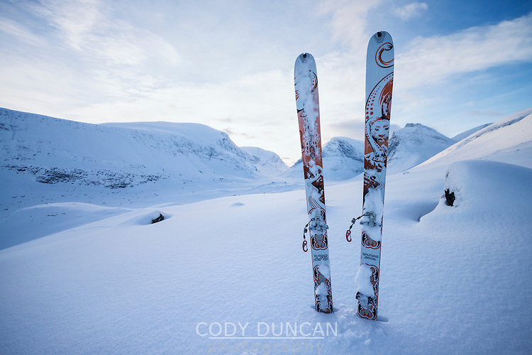 Set of Dynafit touring skis stuck in powder snow on mountain slope, Lapland, Sweden
