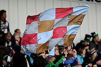 20130317 Copyright onEdition 2013©.Free for editorial use image, please credit: onEdition..A Harlequins fan waves a flag in celebration during the LV= Cup Final between Harlequins and Sale Sharks at Sixways Stadium on Sunday 17th March 2013 (Photo by Rob Munro)..For press contacts contact: Sam Feasey at brandRapport on M: +44 (0)7717 757114 E: SFeasey@brand-rapport.com..If you require a higher resolution image or you have any other onEdition photographic enquiries, please contact onEdition on 0845 900 2 900 or email info@onEdition.com.This image is copyright onEdition 2013©..This image has been supplied by onEdition and must be credited onEdition. The author is asserting his full Moral rights in relation to the publication of this image. Rights for onward transmission of any image or file is not granted or implied. Changing or deleting Copyright information is illegal as specified in the Copyright, Design and Patents Act 1988. If you are in any way unsure of your right to publish this image please contact onEdition on 0845 900 2 900 or email info@onEdition.com