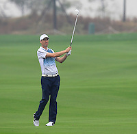 Ross Fisher (ENG) plays his 2nd shot on the 14th hole during Friday's Round 2 of the 2014 BMW Masters held at Lake Malaren, Shanghai, China 31st October 2014.<br /> Picture: Eoin Clarke www.golffile.ie