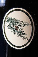 Detail of label with a cedar tree branch on a bottle of Le Cedre from Chateau du Cedre Cahors Lot Valley France