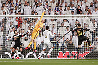 26th February 2020; Estadio Santiago Bernabeu, Madrid, Spain; UEFA Champions League Football, Real Madrid versus Manchester City; Thibaut Courtois (Real Madrid) gets his fingertips to a crossed ball