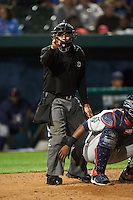Umpire Arturo Gonzalez makes a call during a game between the Cedar Rapids Kernels and South Bend Cubs on June 5, 2015 at Four Winds Field in South Bend, Indiana.  South Bend defeated Cedar Rapids 9-4.  (Mike Janes/Four Seam Images)