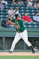 Catcher Arturo Rodriguez (54) of the Greensboro Grasshoppers bats in a game against the Greenville Drive on Wednesday, August 26, 2015, at Fluor Field at the West End in Greenville, South Carolina. Greenville won, 7-0.  (Tom Priddy/Four Seam Images)
