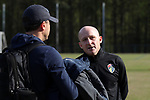 CARY, NC - APRIL 08: Courage head coach Paul Riley (ENG) (right) talks with UNC assistant coach Damon Nahas (left). The NWSL's North Carolina Courage played a preseason game against the University of North Carolina Tar Heels on April 8, 2017, at WakeMed Soccer Park Field 3 in Cary, NC. The Courage won the match 1-0.