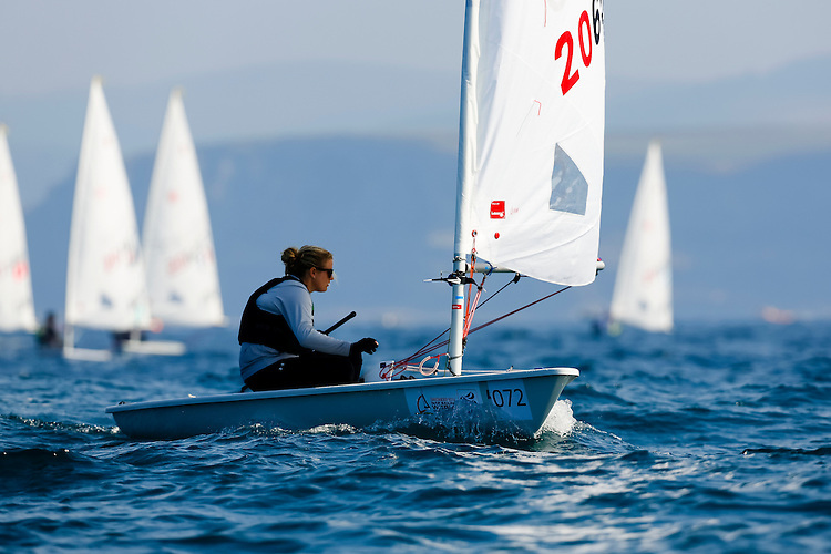 20140912, Santander, Spain: 2014 ISAF SAILING WORLD CHAMPIONSHIPS - More than 1,250 sailors in over 900 boats from 84 nations will compete at the Santander 2014 ISAF Sailing World Championships from 8-21 September 2014. The best sailing talent will be on show and as well as world titles being awarded across ten events 50% of Rio 2016 Olympic Sailing Competition places will be won based on results in Santander. Boat class and Sailor(s): Laser Radial - USA206526 - Claire DENNIS. Photo: Mick Anderson/SAILINGPIX.DK.