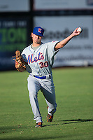 Kingsport Mets starting pitcher Max Wotell (30) warms up in the outfield prior to the game against the Danville Braves at American Legion Post 325 Field on July 9, 2016 in Danville, Virginia.  The Mets defeated the Braves 10-8.  (Brian Westerholt/Four Seam Images)