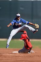 Los Angeles Dodgers shortstop Kelvin Ramos (85) turns a double play as Kevin Garcia (74) slides in during an Instructional League game against the Cincinnati Reds on October 11, 2014 at Goodyear Training Complex in Goodyear, Arizona.  (Mike Janes/Four Seam Images)