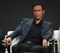 """BEVERLY HILLS - AUGUST 1: Aasif Mandvi onstage during the """"Evil"""" panel at the CBS portion of the Summer 2019 TCA Press Tour at the Beverly Hilton on August 1, 2019 in Los Angeles, California. (Photo by Frank Micelotta/PictureGroup)"""