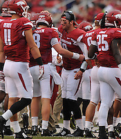 NWA Media/ANDY SHUPE - Arkansas quarterback Brandon Allen, center, greets his brother and backup Austin Allen (8) after an Arkansas touchdown against Nicholls during the fourth quarter Saturday, Sept. 6, 2014, at Razorback Stadium in Fayetteville