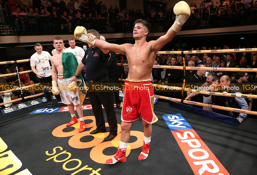 Johnny Coyle (red shorts) defeats Paddy Gallagher (white shorts) to win the title - Welterweights IV Prize Fighter Final - Boxing at York Hall, Bethnal Green, London - 05/04/14 - MANDATORY CREDIT: Rob Newell/TGSPHOTO - Self billing applies where appropriate - 0845 094 6026 - contact@tgsphoto.co.uk - NO UNPAID USE