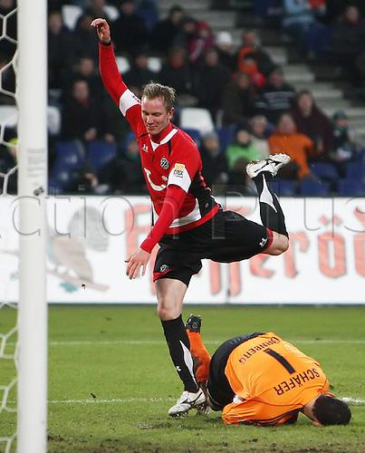 30 01 2010 Hanover Bundesliga  AWD Arena Hanover 96 versus  FC Nuremberg 1- 3.  Nuremberg Goalkeeper Raphael Schafer saves from Jan Rosenthal.
