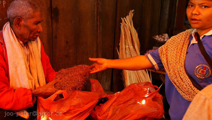 woman buying tobacco on market in Bajawa, island  Flores in archipelago of Indonesia