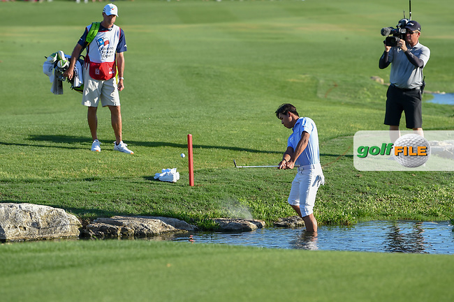 Si Woo Kim (KOR) hits from the water on 18 during day 4 of the Valero Texas Open, at the TPC San Antonio Oaks Course, San Antonio, Texas, USA. 4/7/2019.<br /> Picture: Golffile   Ken Murray<br /> <br /> <br /> All photo usage must carry mandatory copyright credit (© Golffile   Ken Murray)