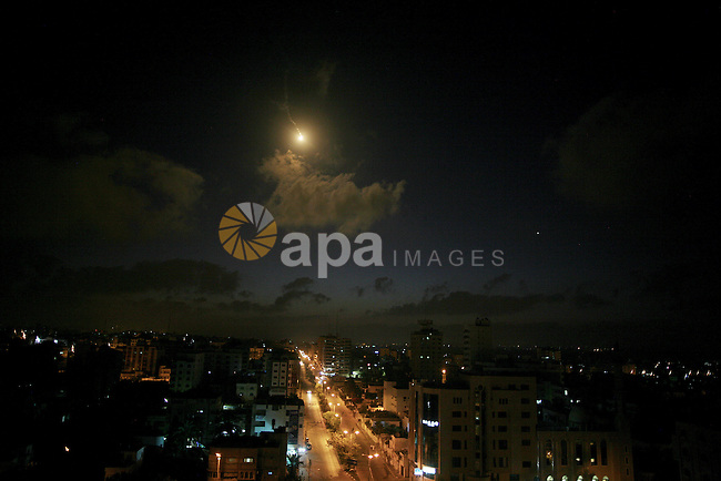 A flare illuminates the sky following an Israel airstrike over Gaza City early on July 3, 2014 as Israeli warplanes launched early morning airstrikes on different targets in the Gaza Strip, including sites belonging to Hamas and Islamic Jihad. Violence also flared in Jerusalem as angry Palestinian youths clashed with Israeli police following the kidnap and murder of a Palestinian teen in an apparent revenge attack, prompting international calls for calm. Photo by Ali Jadallah