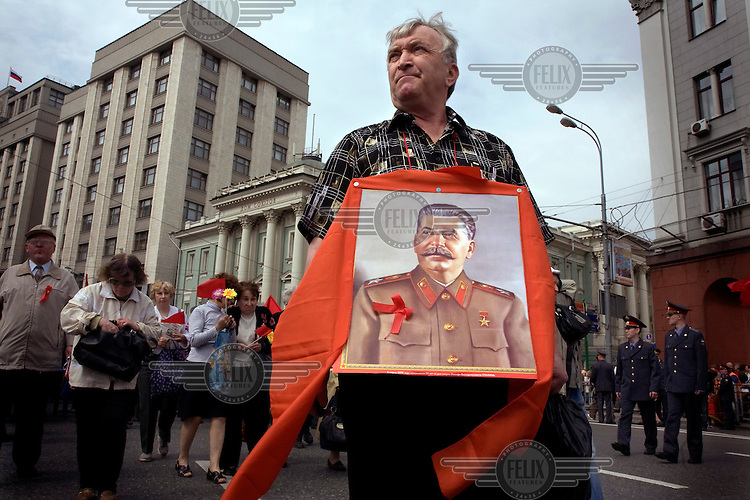 Communist supporters, carrying red flags and portraits of Lenin and Stalin, pour out onto the streets of Moscow on Labour Day to demonstrate.