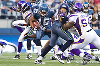 Seattle Seahawks wide receiver Doug Baldwin (15) is tackled in a game against the Minnesota Vikings at CenturyLink Field in Seattle, Washington. The Minnesota Vikings won the game, 20-7.