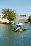 USA, Indiana, Indianapolis, canal in downtown area with paddle boaters.
