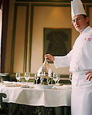 TURKEY, Istanbul, portrait of a chef serving food at Tugra Restaurant