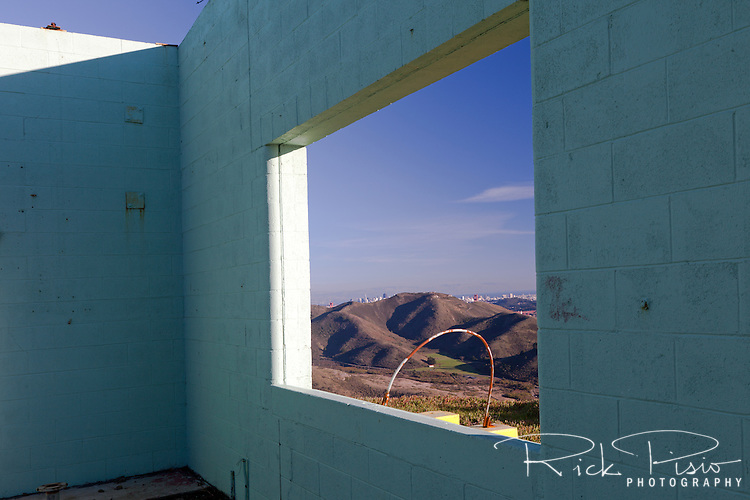 View of the Marin Headlands, Golden Gate, and San Francisco from the windows of the Integrated Fire Control for Nike Missile installation SF88L. SF88L's IFC sits abandoned atop Wolf Ridge in the Marin Headlands and is now part of the Golden Gate National Recreation Area.
