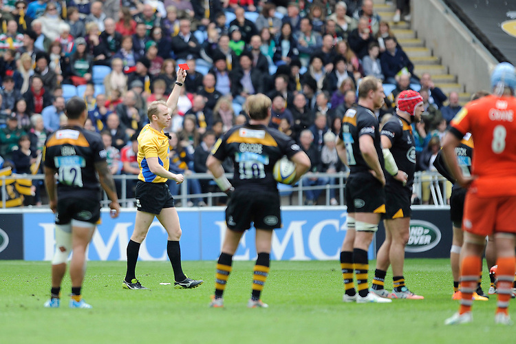 Referee Wayne Barnes converts Seremaia Bai of Leicester Tigers' yellow into a red card after watching the replay on the big screen