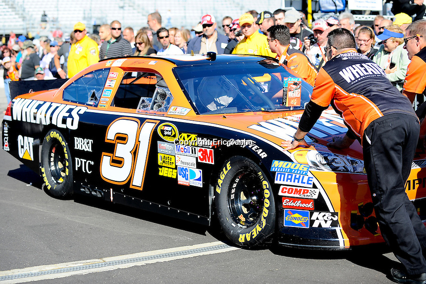 September 23, 2012  Sprint Cup Series driver Jeff Burton's (31) car is pushed pasted into the pit area prior to the start of the  Sylvania 300 race held at the New Hampshire Motor Speedway in Loudon, New Hampshire.  Eric Canha/CSM