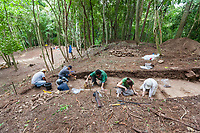Archeologists dig at the ancient Mayan ruins of Carocol, Belize