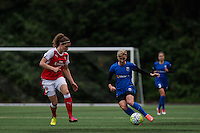 Seattle, WA - Thursday, May 26, 2016: Dominique Janssen (20) of Arsenal Ladies FC marks Seattle Reign FC midfielder Jessica Fishlock (10). The Seattle Reign FC of the National Women's Soccer League (NWSL) and the Arsenal Ladies FC of the Women's Super League (FA WSL) played to a 1-1 tie during an international friendly at Memorial Stadium.