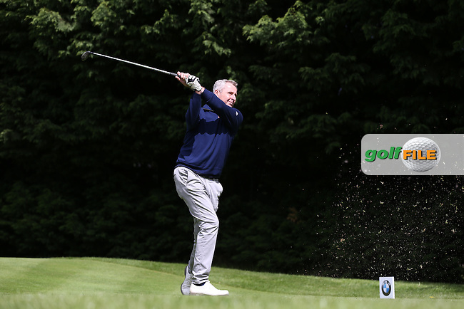 Newsreader Mark Austin drives the 18th  during the Pro-Am ahead of the 2015 BMW PGA Championship over the West Course at Wentworth, Virginia Water, London. Picture David Lloyd, www.golffile.ie: 20/05/2015