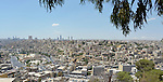 A view of Amman, Jordan, where thousands of Syrians have fled to escape the war in their homeland. Yet they're not permitted to work by the Jordanian government, leaving United Nations agencies and nongovernmental organizations, including several members of the ACT Alliance, to help them survive.