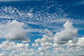 Brasilia, Brazil. Typical Brasilia sky; white puff clouds against a true blue sky.
