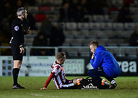 Lincoln City's Danny Rowe receives treatment for an injury from Lincoln City's head of sports science and medicine Mike Hine<br /> <br /> Photographer Chris Vaughan/CameraSport<br /> <br /> The EFL Sky Bet League Two - Lincoln City v Cheltenham Town - Tuesday 13th February 2018 - Sincil Bank - Lincoln<br /> <br /> World Copyright &copy; 2018 CameraSport. All rights reserved. 43 Linden Ave. Countesthorpe. Leicester. England. LE8 5PG - Tel: +44 (0) 116 277 4147 - admin@camerasport.com - www.camerasport.com