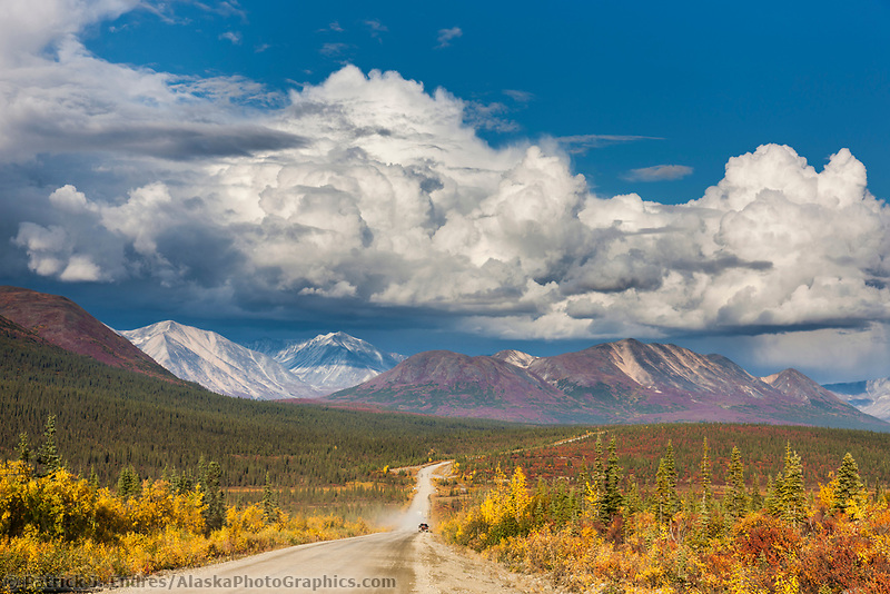Vehicle travels the Denali Highway, a gravel road transecting the Parks and Richardson highways, Interior, Alaska.