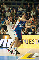 Real Madrid´s Rudy Fernandez and Anadolu Efes´s Furkan Korkmaz during 2014-15 Euroleague Basketball match between Real Madrid and Anadolu Efes at Palacio de los Deportes stadium in Madrid, Spain. December 18, 2014. (ALTERPHOTOS/Luis Fernandez) /NortePhoto /NortePhoto.com