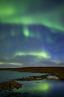 Aurora borealis, (northern lights) over Toolik lake, arctic, Alaska.