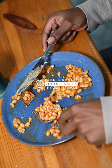 Youth eating a meal,