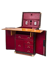 BNPS.co.uk (01202 558833)<br /> Pic: TimothyOulton/BNPS<br /> <br /> Sir Arthur Conan Doyle's custom-made portable desk has emerged for sale for £96,000 - and it is as intricate as one of his Sherlock Holmes' plots.<br /> <br /> On first glance it appears to be a standard leather trunk, before folding out to reveal a wooden desk and a bookcase.<br /> <br /> Conan Doyle, a keen traveller, wanted to be able to continue to write wherever he found himself day to day.<br /> <br /> The desk was devised by the French goods maker Goyard for the prolific author in 1925.<br /> <br /> It is being sold by furniture dealer Timothy Oulton, who has a gallery in Chelsea, west London.