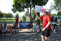 A protestor walks the Independence Day Parade route prior to the parade along Constitution Avenue in Washington DC on July 4, 2019.<br /> CAP/MPI/CNP<br /> ©CNP/MPI/Capital Pictures