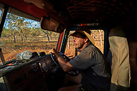 Nick Atkins in the cabin of his truck, perseveres as he drives the endless corrugations of the Gibb River-Kalumburu Road. Moments earlier he had a close call with a caravan overtaking on a corner and exclaimed: ''Flaming rushing tourists, not the Vladimir Putin type, the other ones. Always in a rush to relax.''
