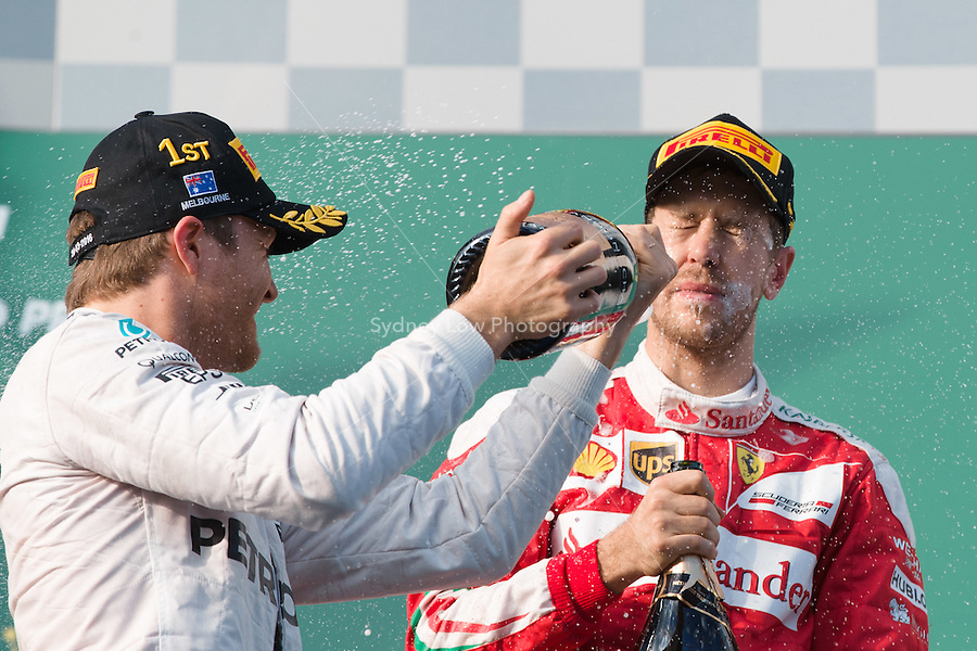 March 20, 2016: Nico Rosberg (DEU) #6 from the Mercedes AMG Petronas team sprays Sebastian Vettel (DEU) #5 from the Scuderia Ferrari team after winning the 2016 Australian Formula One Grand Prix at Albert Park, Melbourne, Australia. Vettel came third. Photo Sydney Low