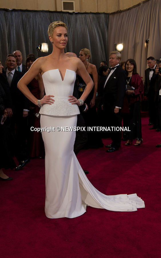 """CHARLIZE THERON..Red Carpet arrival for the 85th Annual Academy Awards, Dolby Theatre, Hollywood, Los Angeles_23/02/2013.Mandatory Photo Credit: ©Dias/Newspix International..**ALL FEES PAYABLE TO: """"NEWSPIX INTERNATIONAL""""**..PHOTO CREDIT MANDATORY!!: NEWSPIX INTERNATIONAL(Failure to credit will incur a surcharge of 100% of reproduction fees)..IMMEDIATE CONFIRMATION OF USAGE REQUIRED:.Newspix International, 31 Chinnery Hill, Bishop's Stortford, ENGLAND CM23 3PS.Tel:+441279 324672  ; Fax: +441279656877.Mobile:  0777568 1153.e-mail: info@newspixinternational.co.uk"""