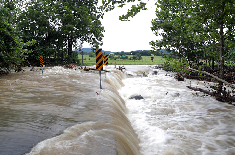 Flood waters from the South River ravage the intersection of Octonia Road and South River Road Friday in Greene County. Photo/Andrew Shurtleff Photography, LLC