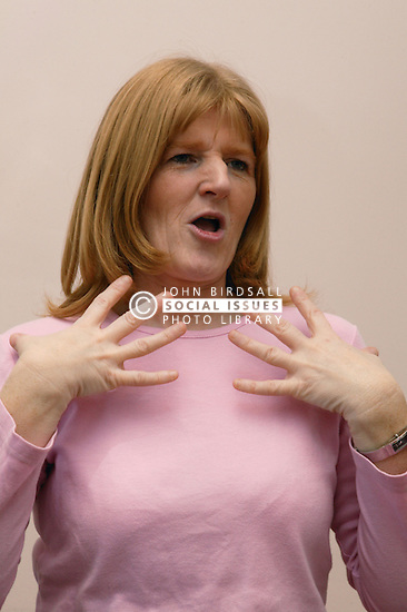 Single parent using sign language in her office,