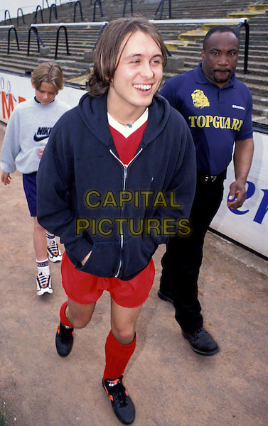 MARK OWEN.Ref: 4938.football kit, footie kit, hands in pockets, full length, full-length.www.capitalpictures.com.sales@capitalpictures.com.© Capital Pictures