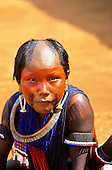 A-Ukre village, Brazil. Kayapo child with red and black face and body paint; Xingu Indigenous Area, Para State.