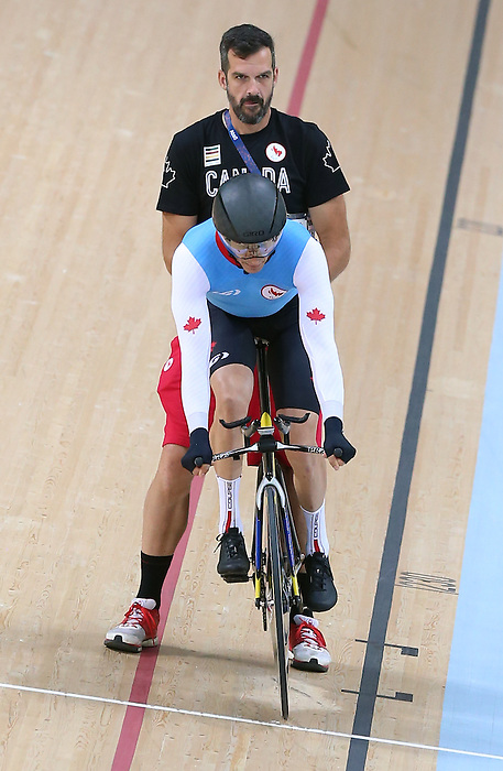 Rio de Janeiro-4/9/2016-Tristan Chernove with coach Jacques Landry during training before his cycling event at the Rio 2016 Paralympic Games at the Barra Velodrome. Photo Scott Grant/Canadian Paralympic Committee