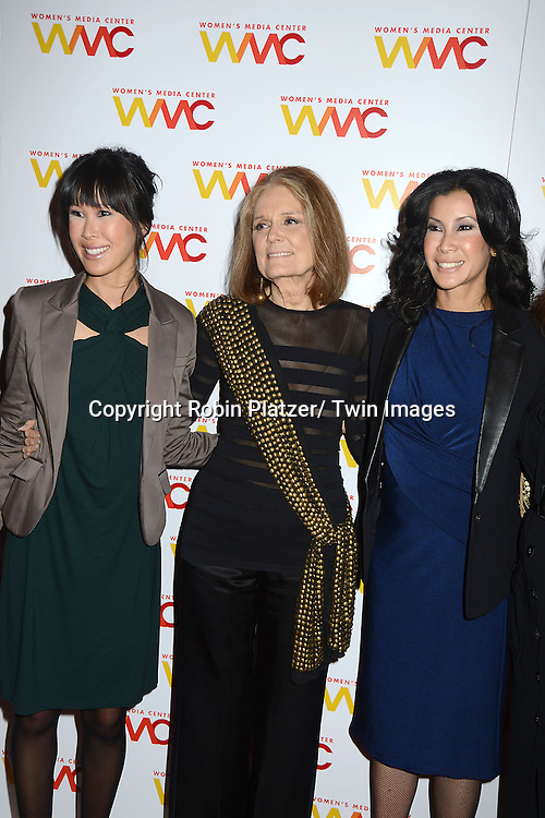 Laura Ling and sister Lisa Ling and Gloria Steinem attend the Women's Media Center 2012 Women's Media Awards on November 13, 2012 at Guastavinos in New York City.