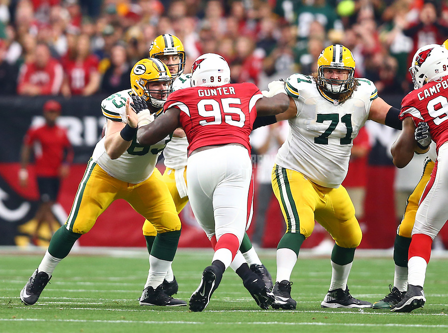 Dec 27, 2015; Glendale, AZ, USA; Green Bay Packers center Corey Linsley (63) and offensive lineman Alex Bars (71) against the Arizona Cardinals at University of Phoenix Stadium. The Cardinals defeated the Packers 38-8. Mandatory Credit: Mark J. Rebilas-USA TODAY Sports